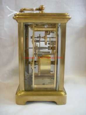 Left side view of carriage clock with cylinder platform